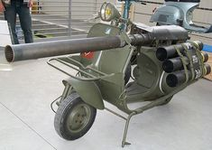 Vespa Scooter?! this is the deadliest Vespa in the world. The military scooter is powered by a single-cylinder 146 cc two-stroke engine. It sports a M20 75 mm recoilless rifle, US-made light anti-armor cannon, and storage for some ammos. The scooter would be parachute-dropped from airplanes, accompanied by a two-man team who'd scoot along in absolutely menacing style.