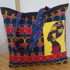 Et un nouveau sac pour Noël terminé ! C'est le cabôtin de sacôtin (modèle gratuit).Fait en wax et coton épais pour la doublure.Grande poche intérieure compartimentée.J'ai ajouté une poche sur le devant avec un appliqué de femme africaine 😊#sacotin#sacôtinaddict#cadeaunoel #cadeauhandmade#waxattitudes #sewingproject #sewingaddict