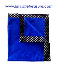 Boys baby blanket $39.95. Blue coral fleece bordered with white stars on a back background. 100cm x 90cm. Made with Cotton and coral fleece. You can purchase this product from www.tinylittletreasure.com