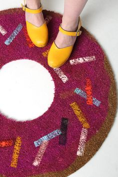 Turn an Ikea welcome mat into a giant doughnut.