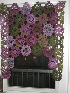 Pretty crochet drapes. You could make these in different colors and change them to complement the season. See Ravelry for the pattern. http://www.ravelry.com/patterns/library/crochet-japanese-flower