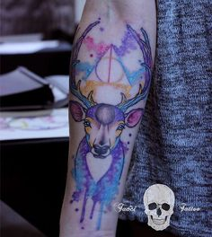 Love this Patronus stag/deathly hallows combo.