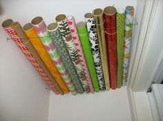 paper storage solution Wrapping paper storage solution--use wire and store it in a closet near the ceiling!Wrapping paper storage solution--use wire and store it in a closet near the ceiling! Wrapping Paper Rolls, Wrapping Paper Storage, Wrapping Papers, Gift Wrapping, Genius Ideas, Amazing Ideas, Ceiling Storage, Overhead Storage, Cheap Storage
