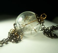 Dandelion Necklace Make A Wish Dandelion Seed Hollow Lampwork Bead Round Necklace- 24 inches. $35.00, via Etsy.