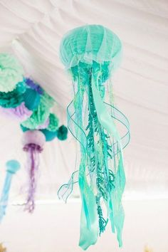 17 Ariel-approved ideas for a mermaid 30th birthday party, like this jellyfish decor.