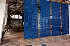 Jensen Architects has completed the design of a new office for design and innovation consulting firm IDEO. The company's San Francisco office is located in the city's Port District. Office Dividers, Space Dividers, Office Partitions, Wall Dividers, Open Office, Cool Office, Blue Office, Corporate Interiors, Office Interiors