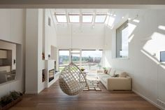 I really love skylights and this little hanging nest/sofa :)
