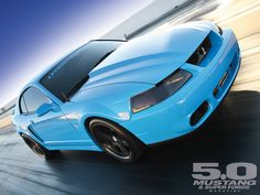 Behold this one of a kind 2003 Ford Mustang Cobra from Lethal Performance. This Grabber Blue colored Mustang is surely not to be missed, check out all the goods in the Power Grab article in the April issue of Mustang & Super Fords Magazine. Mustang Cobra, 2000 Ford Mustang, Ford Svt, Car Ford, Ford Bronco, Lifted Ford Trucks, Chevrolet Trucks, 1957 Chevrolet, 4x4 Trucks