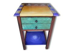Studio 78 Maple Candy Hand-Painted End Table - The Studio 78 Maple Candy Hand-Painted End Table is a custom hand-painted table with double drawers and a bottom shelf, painted by Wendy Grossman. Made in USA.