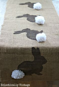 See how to make this burlap bunny table runner - a fun Easter craft and bunny template included! eclecticallyvintage.com