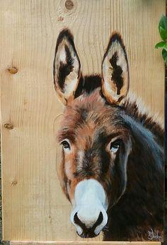 Ezel op houten paneel door Ineke Nolles.
