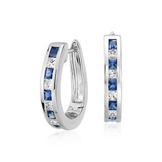 Striking in beauty, these hoop earrings feature beautiful sapphire gemstones and brilliant princess cut diamonds set in 14k white gold.