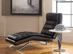 This reclining chaise with buttery soft leather and chrome ski-legs is a perfect addition to any man cave or media room. You can feel the imminent relaxation just looking at it! | Mikel Reclining Chaise cort.com