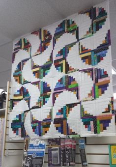 I love looking at the quilt postings on Pinterest. Here is one I found made using my Curvy Log Cabin ruler and my Rainbow Swirls pattern. It...