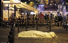 PARIS, FRANCE - NOVEMBER 14:  A victim's body lies covered on Boulevard des Filles du Calvaire, close to the Bataclan theatre