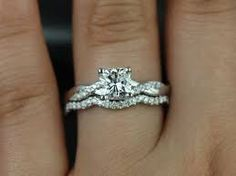 Image result for twisted wedding rings for women