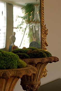 Urns with moss. Simple & festive.  Even Walmart sells moss pods like these!