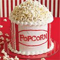 Tub of Popcorn Cake (Movie themed party). Totally did this for my husband's 25 birthday party. So cute! Instead of doing an icing filling between the layers we did strawberry preserves with the chocolate cake. So yummy!