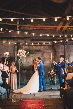 ceremony kiss - photo by Lisa Czech Photography http://ruffledblog.com/maine-wedding-with-industrial-charm