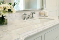 cambria quartz torquay looks like marble countertop but is more affordable and durable as shown on this bathroom vanity