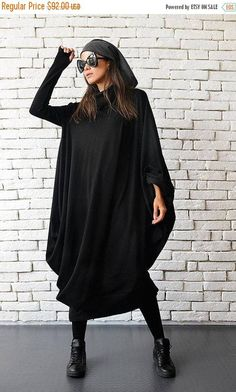 Maxi Black Dress - METD0018 This is the most comfortable dress you will ever wear! You just wont feel it on the body. A great suit for every day use and of course it is beautiful and stylish. The dress is asymmetrical and very loose, that makes it suitable for all body forms and