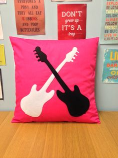 Rock & Roll  A fantastic bright pink cushion cover with a black and white guitar applique Really eye-catching and perfect to add your own unique style to a room!  Available in sizes: 14 x 14 inch 16 x 16 inch 18 x 18 inch 20 x 20 inch 22 x 22 inch 24 x 24 inch  Appliqués are machine stitched on to the cover, no glue is used in the making The reverse has matching fabric and an easy access envelope style opening  Sale is for the cover only, pad is not included. Handmade with love in our UK ...