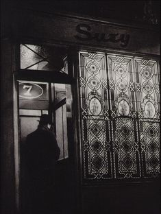 Brassai - House of illusion from paris by night 1933