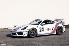 This awesome Martini-livery Porsche Cayman GT4 is another race-prepped Cayman from California's SP Motorsports. It's equipped with a BBi GT4 roll bar, GT4 Clubsport steering wheel, Recaro race seat, and Schroth harnesses. And it rides on an SPM suspension kit, JRZ 3-way adjustable remote reservoir coilovers, and 19x9/19x10.5 Forgeline one piece forged monoblock GS1R wheels finished in Satin Gunmetal. See more at: http://www.forgeline.com/customer_gallery_view.php?cvk=1802 #Porsche