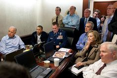 Obama and Staff in the Situation Room Staffers get a key update on the progress of the Osama Bin Laden compound raid. A confidential document has been pixelated in the foreground.