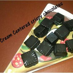 Cream filled crispy chocolates :) .. check out on my YouTube channel Ingredients: Tempered Dark 🍫 chocolate Puffed Rice 🍚  whipped 🍦cream  other things: Piping Bag chocolate molds