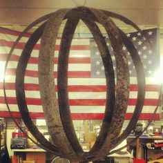 Metal rings from a old oak barrel made into a hanging piece of art