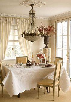 Room of the Day ~ so pretty- tablecloth, elegant and spare chairs, chandelier, column in corner with urn - simple & charming 11.27.2013