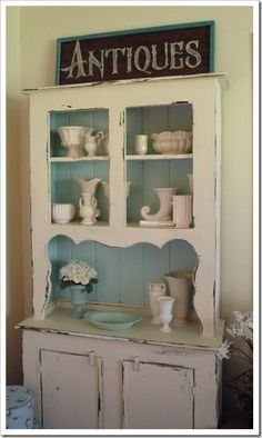 painted hutch. I sort of want to do this to my Gram's hutch. I wonder if she would be okay with it if she were here.