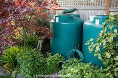 Rainwater cisterns water storage connected to gutter in small space backyard garden #garden #water #storage #aboutthegarden