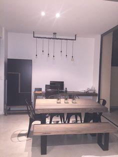 DIY exposed Edison bulbs lighting feature. Industrial design. Steel wood furniture