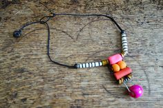 Black waxed cord macrame necklace with bone clay and wood