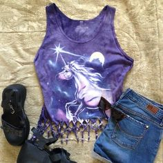 Cropped beaded fringe woven unicorn tank tie dye Upcycled unicorn tank created by yours truly with woven fringe bottom, alternating purple and sparkly beads, and awesome mystical unicorn print. Very special and one of a kind tank top also has woven sides and a woven heart on the back. Fabric is a tie dyed purple. Made from a men's large tank and can fit medium, large, or extra large depending on what kind of fit you want. Very small tear at the back has been carefully sewn back together…