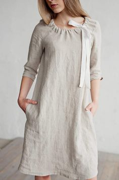 Etsy Linen dress with tie around neck. 10 colours. Handmade linen women's clothing. Loose fitted dress. Premium quality linen is handcrafted after ordering. Feature adjustable neck hole (tie around neck),3/4 sleeves, knee length, two hidden side pockets, and a bit slim fit. Perfect for both everyday use and special occasions