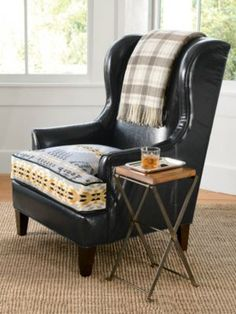 LEATHER/JACQUARD LOGAN CHAIR. I have a navy leather chair with a seat destroyed by my wonderful dog. This would be a perfect rehab.