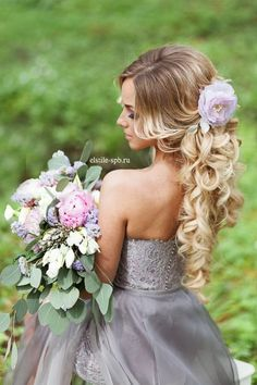 long curly hairstyle with lavender flower
