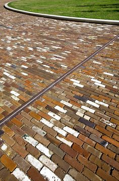 If I won an extraordinary amount of money! I would buy Old Detroit Brick Homes to Brick Pave Driveway!