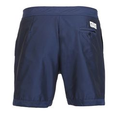 BOARDSHORTS COLOR NAVY BLUE Navy blue memory contact polyester mid-length Boardshorts. Fixed waistband with Velcro closure and adjustable drawstring. Two front pockets and back buttoned pocket. Cuisse de Grenouille brand patch on back. Internal net. COMPOSITION: 100% POLYESTER. Model wears size L, he is 189 cm tall and weighs 86 Kg.
