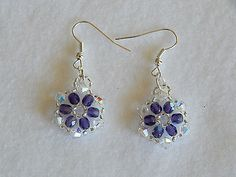 boucles d'oreilles flocon p.de verre violet et cristal swarovski blanc €5