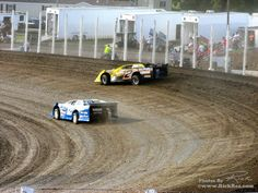 Photo: #12s Nestle S Transport Late Model of Brad Seng passing on the low side of the #2 Late Model of Bill Mooney at River Cities Speedway The Bullring in Grand Forks ND (2012)