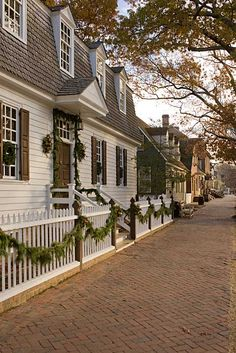 Colonial Willamsburg style: the architecture, the colors and accents on the outside of the old buildings there, the Christmas décor...one of these days, I would like to have a home that has an outside that looks like this.
