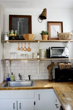 Keep It Simple - The 19 Most Incredible Small Spaces on Pinterest - Southernliving. This kitchen transformation relies on the classic moves: plenty of natural light, open shelves, and lots of white. From there, artfully arranged kitchen tools elevate the hard-working space.   See Pin