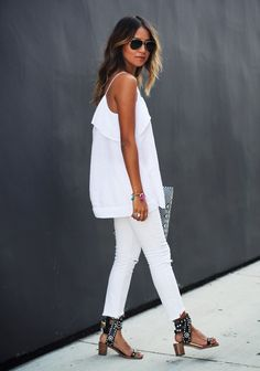 Sincerely, Jules - Madewell ruffled cami and Free People distressed jeans. Black studded Isabel Marant sandals complete the all white look.