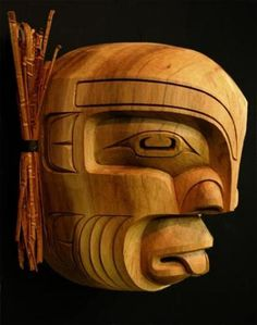 A Native American Indian art piece which is a beautifully carved mask of Pugwis on display at the Just Art Gallery in Port McNeill on Northern Vancouver Island. Arte Inuit, Inuit Art, Native American Masks, American Indian Art, Native Indian, Native Art, Art Sculpture, Masks Art, Indigenous Art