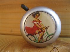 If someone wanted to get this for me for a shower gift I would love them forever! bike bell 1950's Varga style pinup on bike by SpokeNWheel on Etsy, $16.00