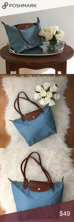 Longchamp Le Pliage Light Blue Nylon Tote ❌NO TRADES❌  - 💯 Authentic Longchamp Le Pliage Light Blue Nylon Tote  - LE PLIAGE SMALL TOTE BAG IN LIGHT BLUE NYLON  - ultra lightweight nylon canvas model with slender straps and a snap closure leather flap  - Approx. dimensions 11x9 3/4x5 1/2 inches  - Used condition. Dirty, Marks inside. Marks, puckering  & stains on outer throughout. Handles show little wear. Functioning zipper & button clasp. Corners of the bag show wear/fray/small holes (see…
